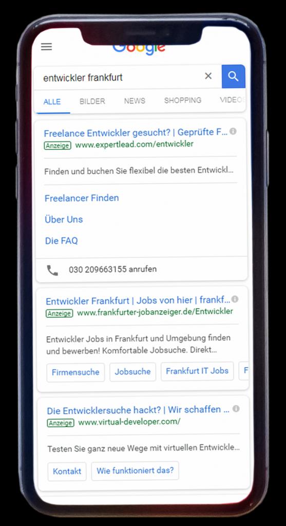 """Smartphone mit den Werbeanzeigen zu """"entwickler frankfurt"""""""